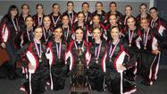 More than a dozen members of the award-winning Maine South Hawkettes dance team told the Township High School District 207 board recently that it was unfair to penalize a coach because of a district policy intended to prevent conflicts of interest.