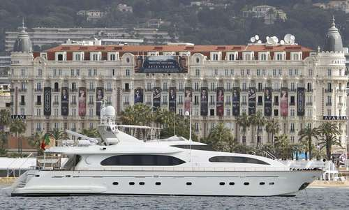 A yacht cruises past the Carlton Hotel on the eve of the opening of the 66th Cannes Film Festival in Cannes May 14, 2013.
