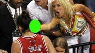 "Miami Heat fan Filomena Tobias, who was pictured flipping the bird at a Chicago Bulls player, has issued a statement through an attorney, calling all the attention she has received ""needless."""