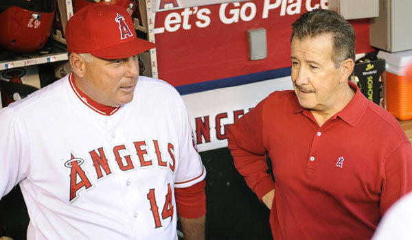 Angels owner Arte Moreno, right, says Manager Mike Scioscia isn't going anywhere.