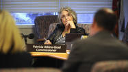 Embattled Commissioner Patte Atkins-Grad was formally served paperwork by the city Wednesday afternoon, which included a certified copy of the petition calling for her recall. She was asked to sign a receipt.
