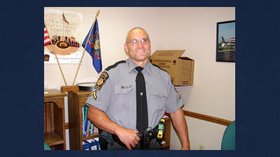Trooper First Class Gregg Norton before a press conference on Wednesday.