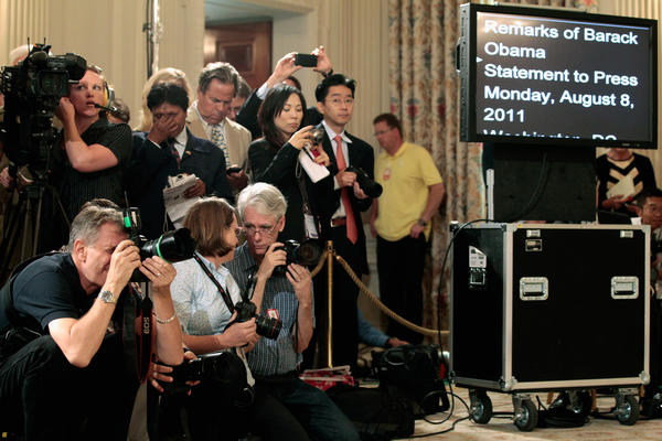 Journalists wait for the arrival of President Barack Obama in the State Dining Room of the White House in 2011.