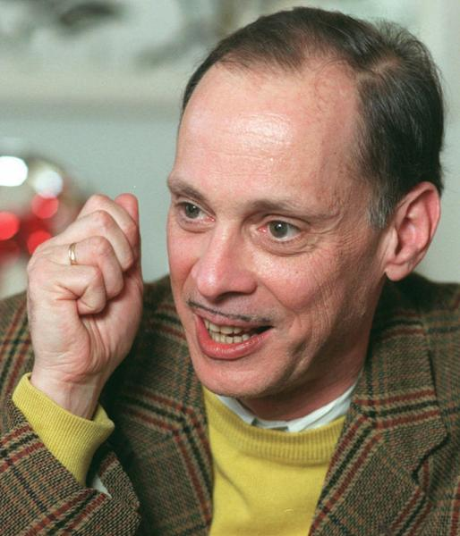 "Writer/ Director John Waters in his Baltimore home. His classic movie ""Pink Flamingos"" is being re-released."