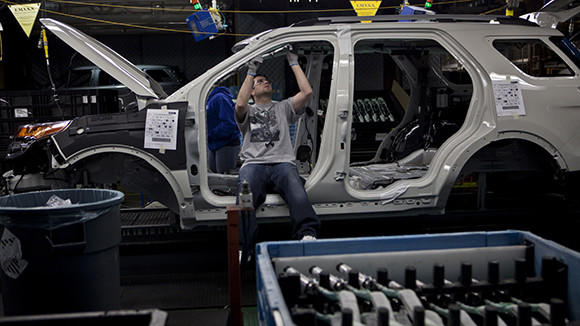 A worker on the assembly line for the Ford Explorer at the Detroit automaker's Chicago assembly plant.