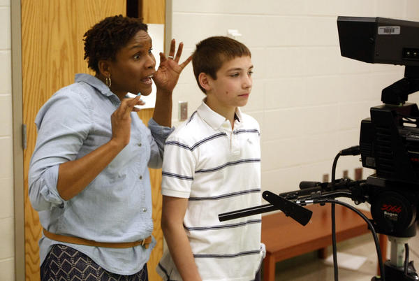 Kathy Burnette, the library media specialist at Discovery Middle School in Granger, makes a face to get student anchor Adam Davis to smile as she supervises the schools life daily TV news broadcast on Wednesday. She is Teacher of the Year in the Penn-Harris-Madison School Corp. (South Bend Tribune/GREG SWIERCZ)
