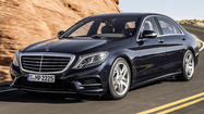 HAMBURG (Reuters) - Germany's Daimler pulled the covers off its new flagship Mercedes-Benz S-Class luxury sedan on Wednesday, a critical product launch for a company struggling to make a dent in the lead that rivals BMW and Audi enjoy in sales and profit.