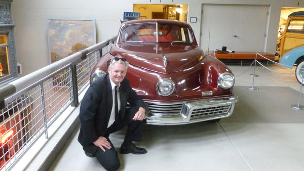 Australian Brendan Edgerton, posing with a Tucker 48 at the LaPorte County Historical Society Museum, is driving from the West Coast to the East Coast in his quest to see every Tucker still in existence. (Photo provided)