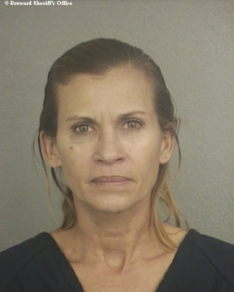 Former U.S. Postal Service worker Aida Luz Maldonado, 49, of Coral Springs, was sentenced to a year in federal prison for stealing and opening mail containing gift cards on her delivery route in Miami-Dade County.