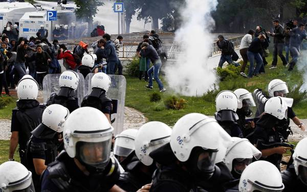 Turkish students protesting the bombing attacks in Reyhanli clash with riot police in Ankara, the capital. Prime Minister Recep Tayyip Erdogan faces strong domestic pressure after the attacks, which are seen as a backlash for Turkey's support for Syrian rebels.
