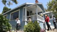 California's housing market surged last month as prices jumped from Southern California to the San Francisco Bay Area.