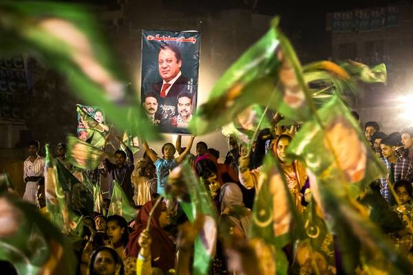 Supporters wait for the arrival of Nawaz Sharif, leader of the Pakistan Muslim League, for his final campaign rally last week in Lahore.