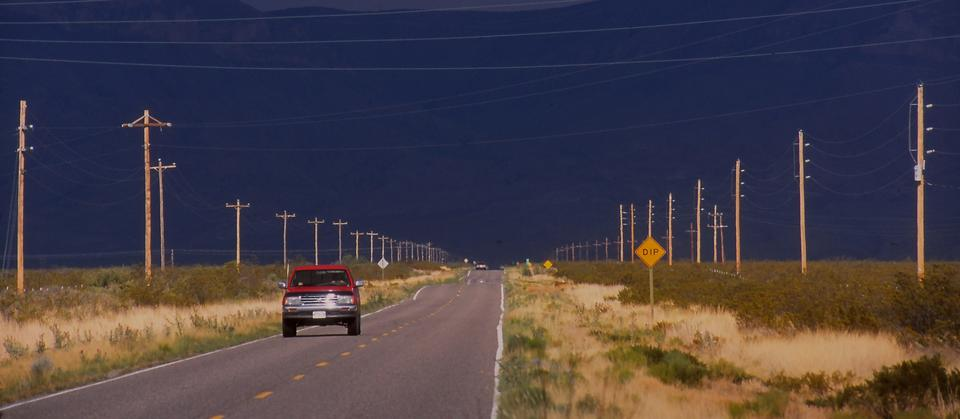 """We were on a highway somewhere east of Hillsboro when the storm clouds massed ahead of us, yet left a strange sunny patch overhead. A few minutes later, the storm gave us the back of its hand -- summer rain so hard we had to pull over for a while. Taken in 2001.  <br /><br />Read more: <a href=""""http://articles.latimes.com/2001/jul/22/travel/tr-25257/3"""">On the path to the perfect storm</a>"""