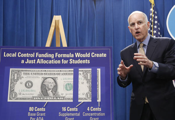 Gov. Jerry Brown responds to a question concerning his plan to give more local control over education funding as he discussed his revised 2013-14 state budget plan at the Capitol.