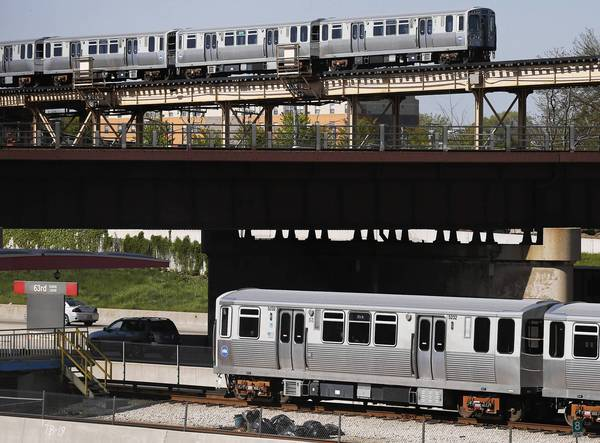 CTA Green and Red line trains pass each other near 63rd Street. During the south leg reconstruction project, the Red Line will travel along Green Line tracks to Ashland/63rd.