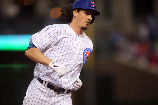 Cubs starting pitcher Jeff Samardzija rounds the bases after his two-run home run in the second inning.