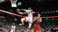 Heat blow lead, find way to finish off Bulls 94-91