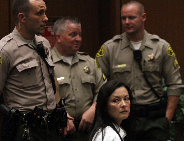 Kelly Soo Park looks back at the audience as opening motions are made in her murder trial.