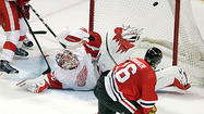 Johnny Oduya usually hugs the boards when cruising into the Blackhawks' offensive zone, but this time the defenseman headed to open ice.