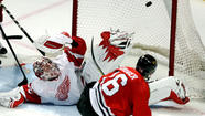 Blackhawks topple Red Wings in series opener