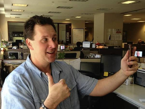 """Tribune reporter Rex Huppke poses for a """"selfie"""" while a """"dopie"""" is photographed of him."""