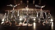"The tumblers and aerialists fly high in Cirque du Soleil's touring show ""Quidam,"" stopping through the weekend at the UCF Arena. So does the imagination, which soars in this thrilling show through costumes, imagery, light and sound."