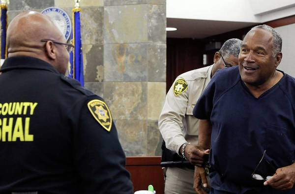 O.J. Simpson is handcuffed and escorted away from the witness stand during a break at Clark County District Court in Las Vegas.
