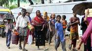 CHITTAGONG, Bangladesh (Reuters) - Cyclone Mahasen buffeted Bangladesh's low-lying coast on Thursday, killing six people after forcing many thousands into emergency shelters, but authorities downgraded warnings later in the day as the storm lost strength.