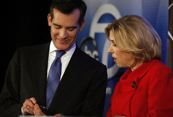 Candidates for Los Angeles mayor Eric Garcetti and Wendy Greuel talk on stage before a debate at Cal State L.A.'s Edmund G.
