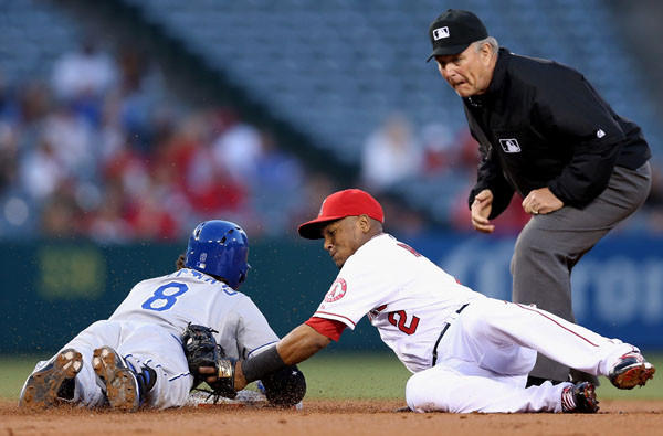 Royals third baseman Mike Moustakas slides safety into second base with a double ahead of the tag by Angels shortstop Erick Aybar in the second inning Wednesday night.