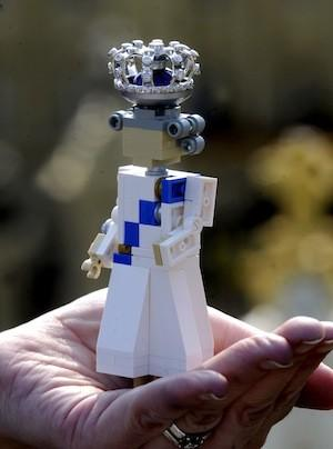 A 4-inch Lego replica of Queen Elizabeth dons a mini-crown with 48 cut diamonds that will be on display at two Legolands in England.