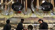 Cooks work the line at Pei Wei Asian Diner, one of three new eateries in Terminal 3 at Fort Lauderdale-Hollywood International Airport.  Jamba Juice and Steak n' Shake outlets recently opened there, too.