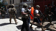 KABUL (Reuters) - A suicide bomber in a car attacked a convoy of foreign troops in Kabul on Thursday, killing at least 15 people including six Americans, Afghan and foreign officials said, in one of the worst attacks in the Afghan capital in months.