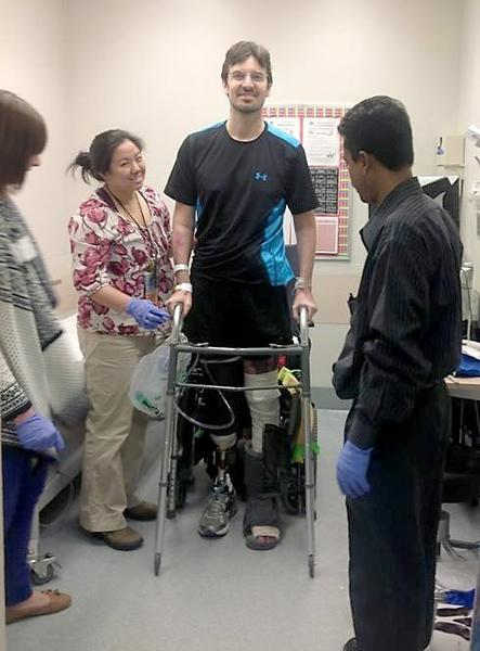 Damian Kevitt takes his first steps on a his new prosthetic leg. Kevitt lost a portion of his leg after being struck by a hit-and-run driver.