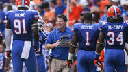 UF coach Will Muschamp expects his players to hit weight room during offseason | Video
