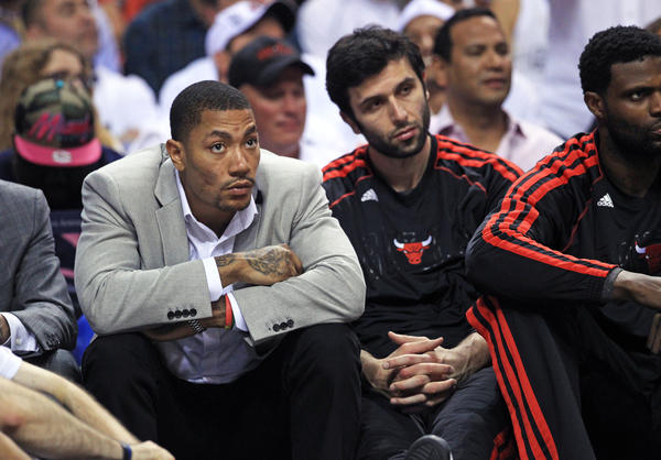 Bulls point guard Derrick Rose (1) watches the final minutes of his team's loss to the Miami Heat on Wednesday.