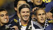 Beckham celebrates with sons