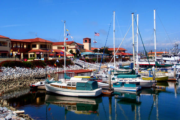 The boating and harbor life is all around the Ventura area.  Here Ventura Harbor reflects the boats with a floating B&B in the foreground.