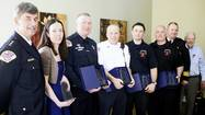 A team of firefighters who saved a woman's life the day after Christmas and a police officer who thwarted an attempted suicide last October were all recognized for their efforts last week at an awards ceremony in Park Ridge.