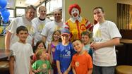 On Wednesday, May 15, La Grange park Little League held a McCoaches Night at the newly remodeled Westchester McDonald's and made $ for some new team equipment. Coaches took over the restaurant serving up delicious meals to the players and families to raise money for the league. The McCoaches jobs included; drive-thru coach, greeters, front counter coaches, and coaches on the ice cream machine. The coaches working included the following: Drew, Tom, Craig, Jose, Tim, Rick and Jeff. A very special thank you to Drew McElligott for organizing the event. La Grange park Little League had it all covered, and the families all had a great time.