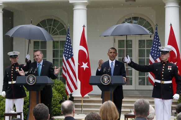 Marines hold umbrellas for President Obama and Turkish Prime Minister Recep Tayyip Erdogan in a light drizzle during their joint news conference in the Rose Garden.