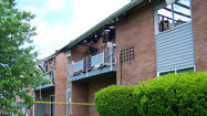 Two people were injured and 26 residents were displaced when a fire tore through an apartment building early Thursday at the Fairlawn Gardens apartment complex in Martinsburg, W.Va., a fire official said.