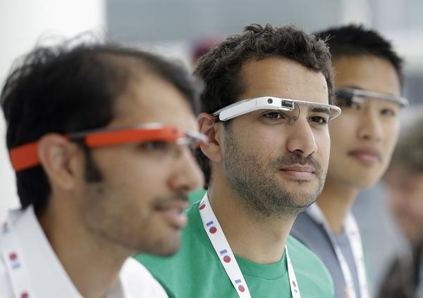 Google Glass team members wear Google Glass at a booth at Google's annual developers conference in San Francisco.