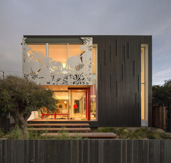 A floral silhouette cut into the second-floor aluminum screen creates a facade that wins second looks from passersby in Venice. Red accents on the ground floor of the house, designed by architect-owners Jonathan Ward and Jin Ah Park, reappear elsewhere, including on another aluminum panel visible from the interior courtyard.
