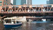 An electric boat passes under the old Wells Street bridge.