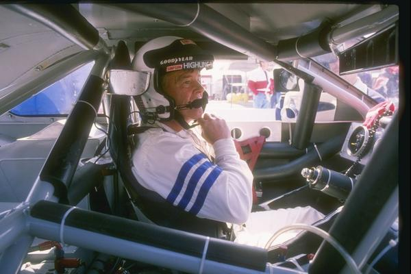 Dick Trickle sits in his car before the start of a 1993 NASCAR race.
