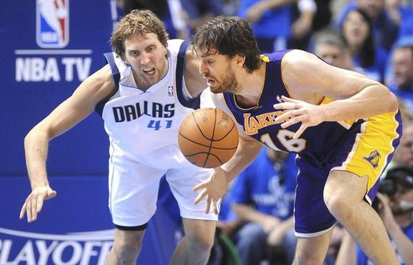 Lakers' Pau Gasol fumbles the ball against Mavericks' Dirk Nowitzki on May 6, 2011.