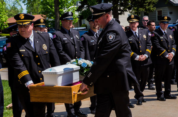 """Chicago Ridge Police Chief Robert Pyznarski, left, and Det. Jake Cholke carry a casket with Jeremiah Michael for a funeral at Our Lady of the Ridge Catholic Church. Father Wayne Svida was presiding at the funeral for """"Baby Jeremiah"""", an unidentified baby found this month inside a cooler at a Chicago Ridge recycling center."""