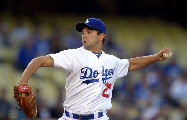 Dodgers starting pitcher Ted Lilly throws against the Colorado Rockies on April 29.