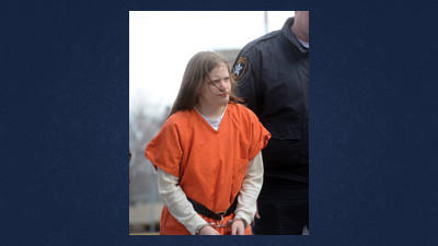 Erin Everett is escorted to court hearing.
